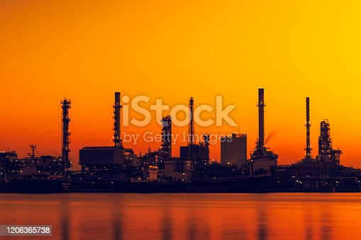 istock Silhouette of oil and gas refinery industry plant with glitter lighting and sunrise in the morning, Factory of petroleum industrial, Power plant,Energy power station area. 1206365738