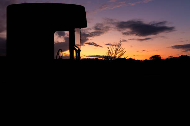 Silhouette Of Old Abandoned Famring Machinery stock photo