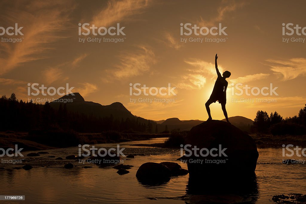 Silhouette of Outdoor Yoga, Reverse Warrior stock photo