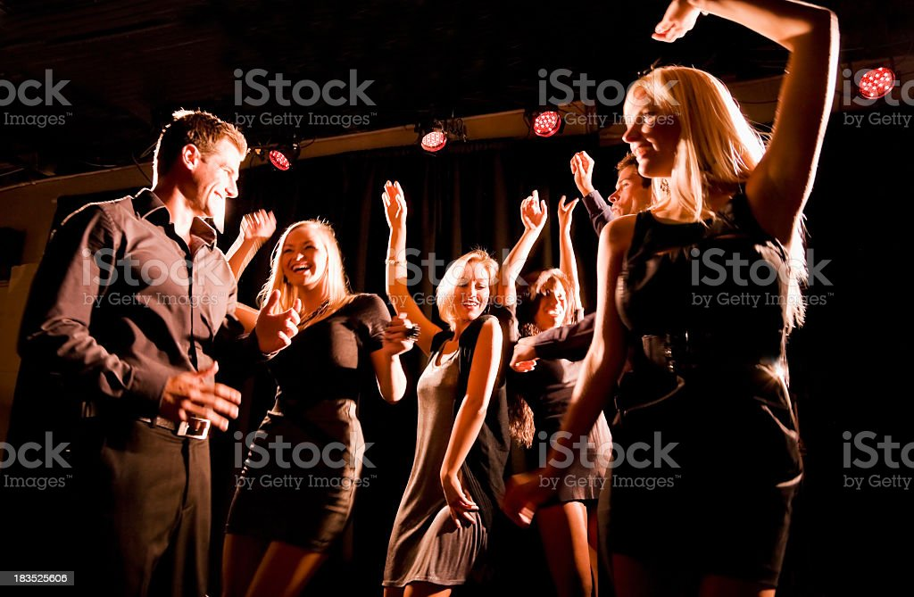 Silhouette of people dancing in nightclub royalty-free stock photo