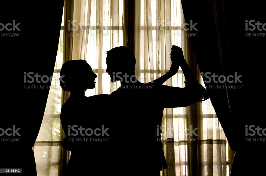 SIlhouette of People Doing Tango Dance Near Window royalty-free stock photo