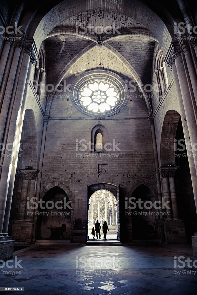Silhouette of People Entering La Seu Vella Cathedral stock photo
