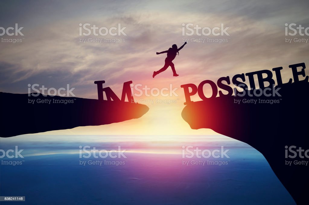 Silhouette of people jumping from cliff to other bank, concept as possible and impossible of success in business and leadership stock photo