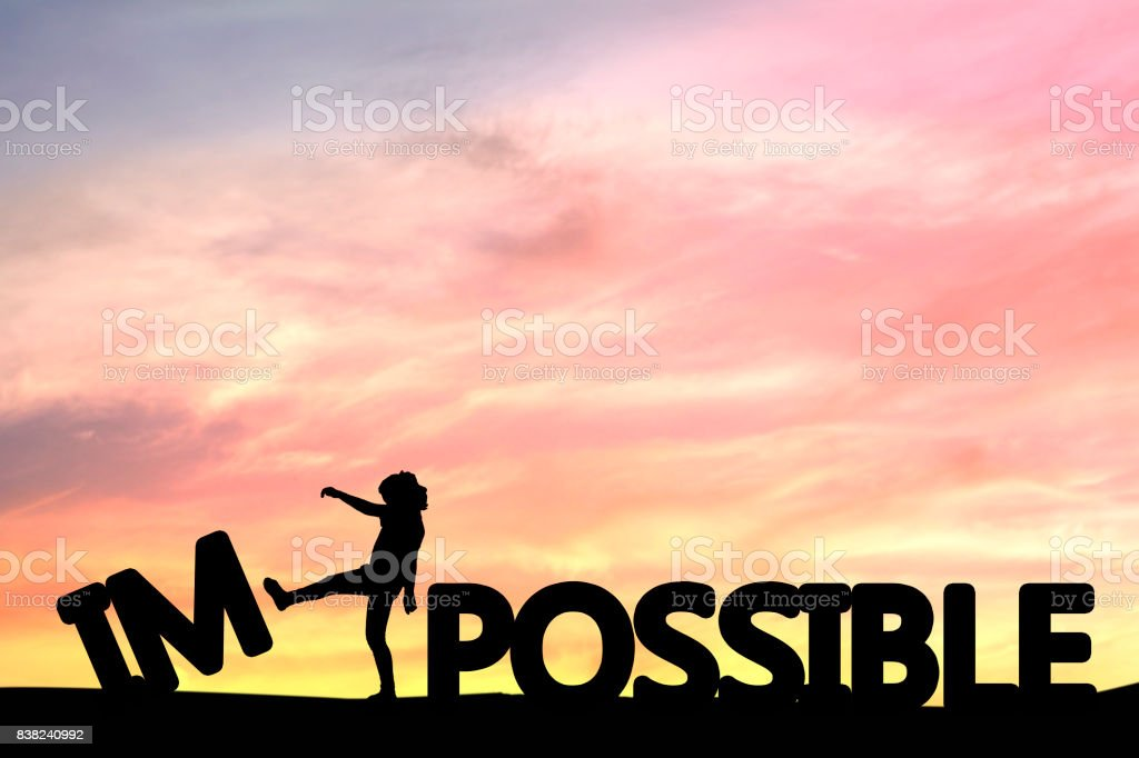 Silhouette of people kick impossible to be possible, concept as success in business and leadership stock photo