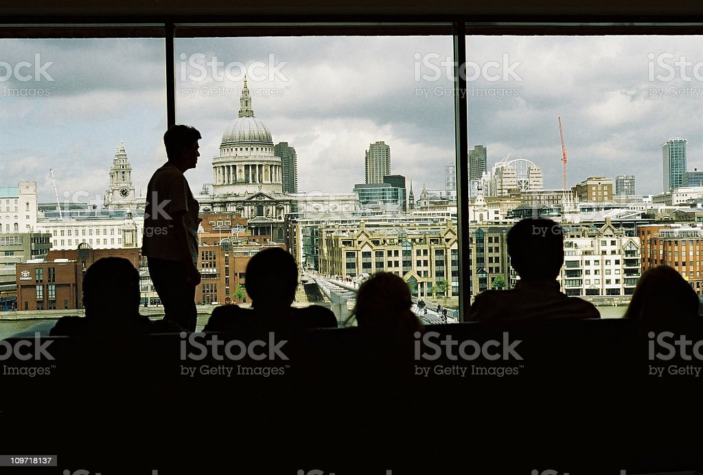 Silhouette of People Looking Out Window at London royalty-free stock photo