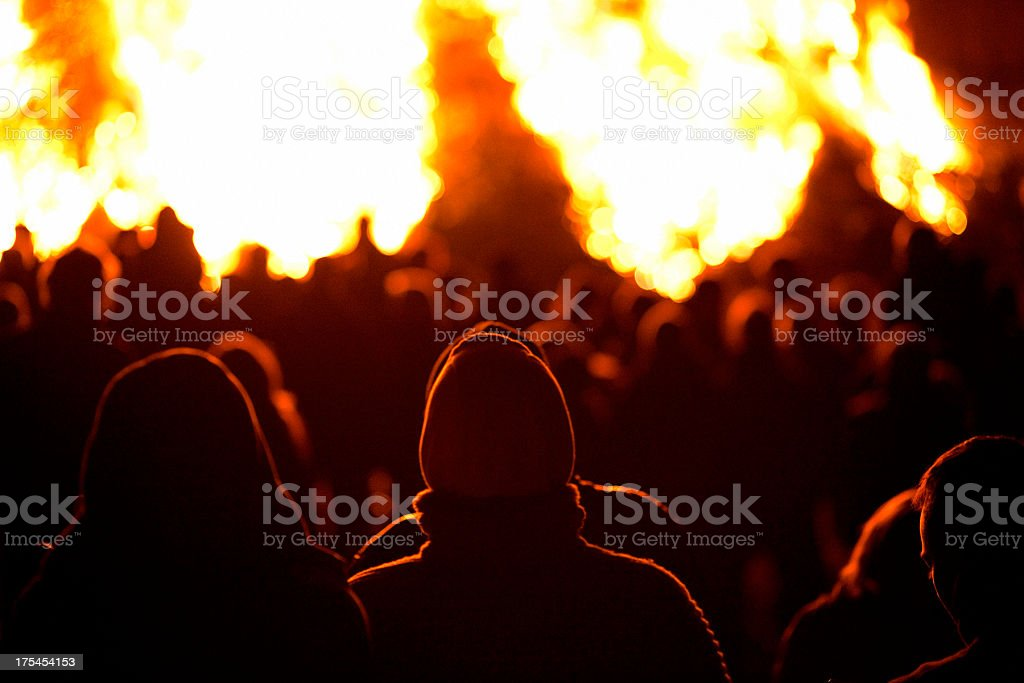 Silhouette of people on fire at night stock photo
