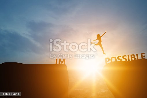 Silhouette of people success and chance impossible to possible text on cliff in sunset , can and development concept