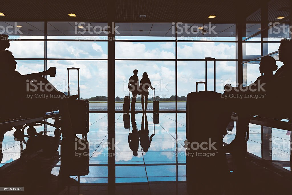 Silhouette of people waiting at airport lounge stock photo
