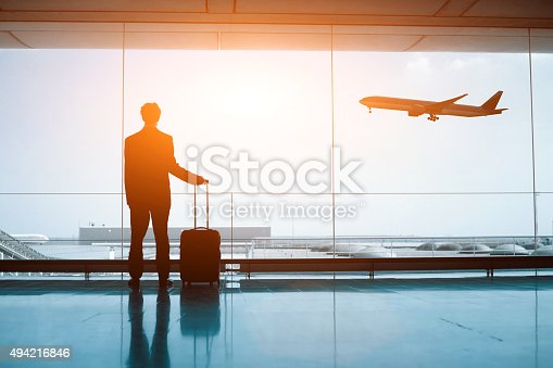 istock silhouette of person in the airport 494216846