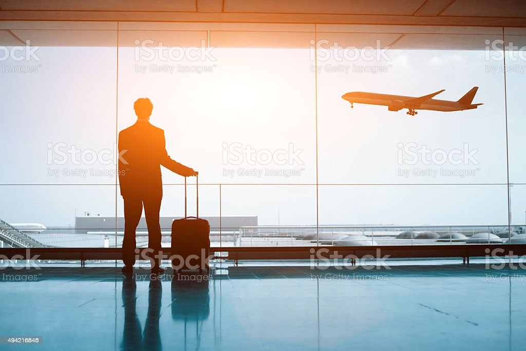 silhouette of person in the airport stock photo