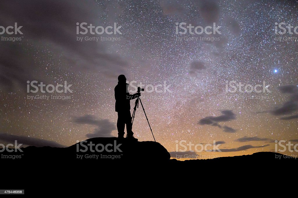 Silhouette of Photographer at Night stock photo