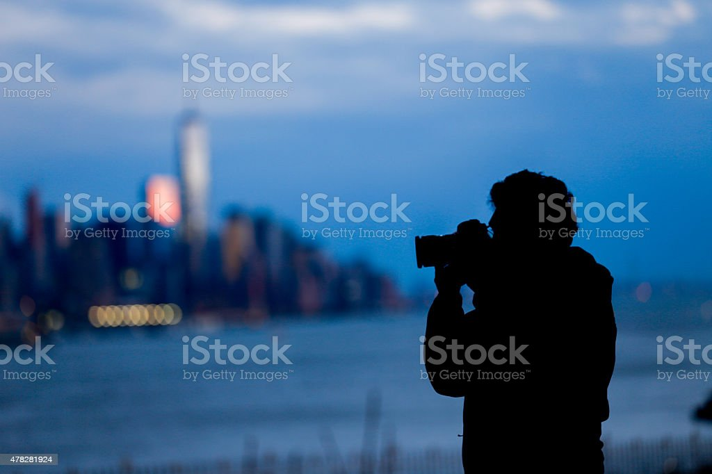Silhouette of Photographer Man stock photo