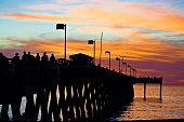 Seascape. Silhouette of pier under beautiful sunset, created in Venice Beach, FL, 01/02/2019