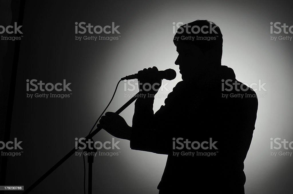 Silhouette der pop-Sängerin und Moderator. – Foto