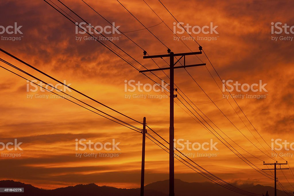Silhouette of powerlines stock photo