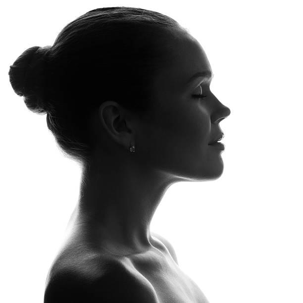 silhouette der schönen frau - gegenlicht stock-fotos und bilder