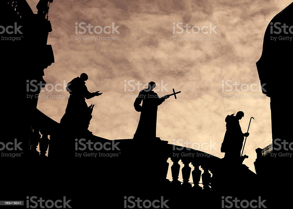 Silhouette of Priest Statues on a church stock photo