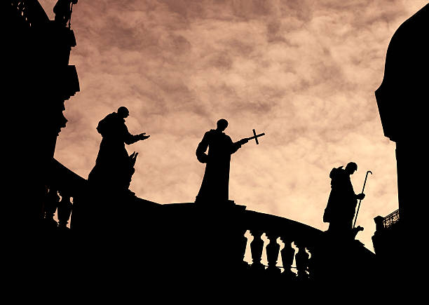 Silhouette of Priest Statues on a church Silhouette of Priest Statues on a church friar stock pictures, royalty-free photos & images