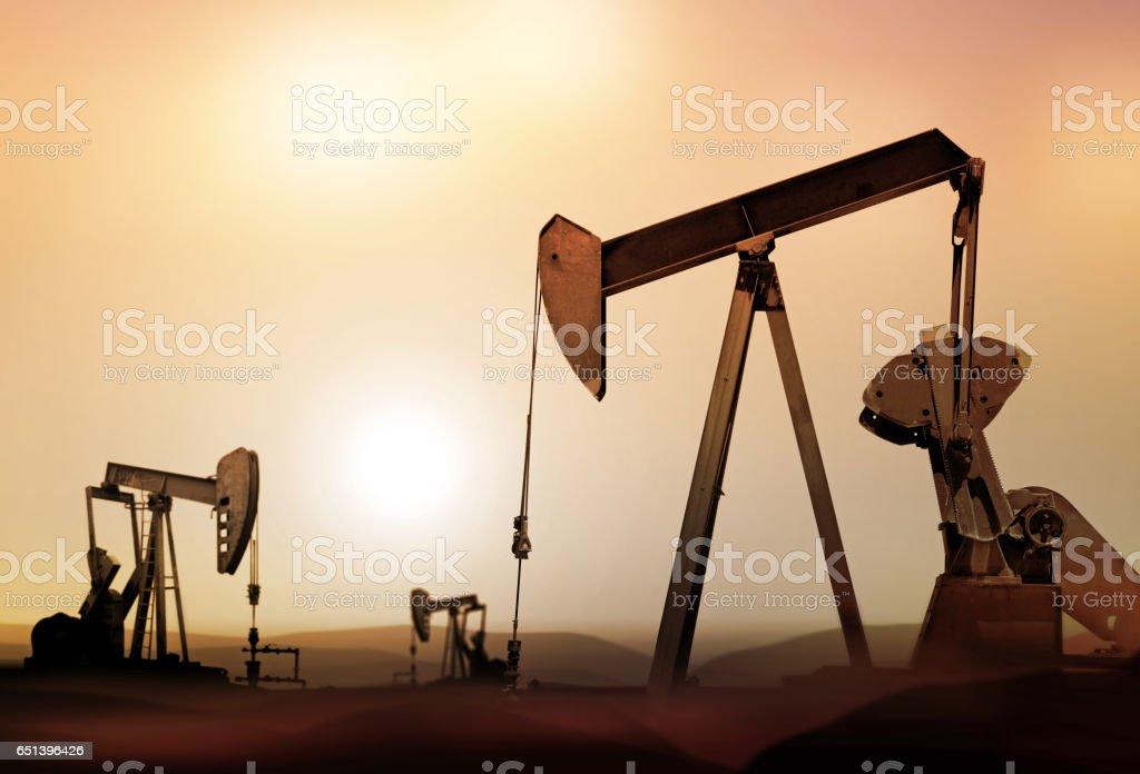 silhouette of retro oil pumps stock photo