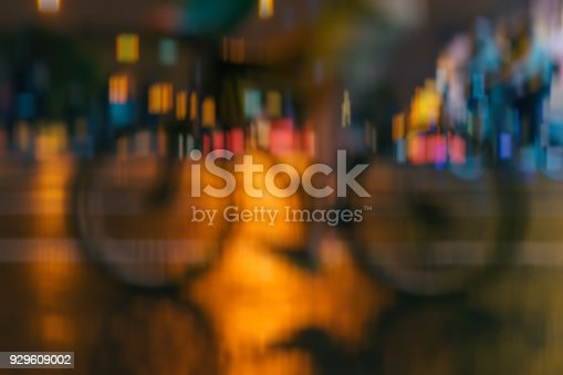 929609038istockphoto Silhouette of riding Cyclists on the city roadway, night light, bokeh, abstract, motion blur, for modern background 929609002