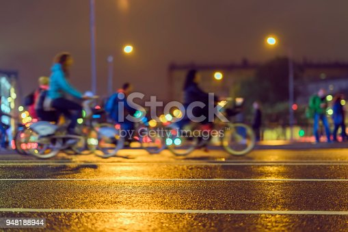 929609038istockphoto Silhouette of riding cyclists. Parade of bicyclists in city, night, abstract. Sport, fitness and healthy lifestyle concept. Intentional motion blur 948188944