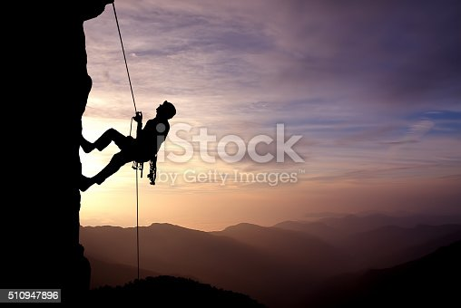 istock Silhouette of Rock Climber at Sunset 510947896