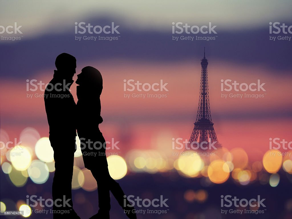 silhouette of romantic lovers with eiffel tower in Paris stock photo