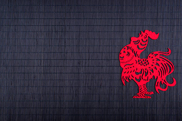 Silhouette of rooster on black bamboo mat - Photo