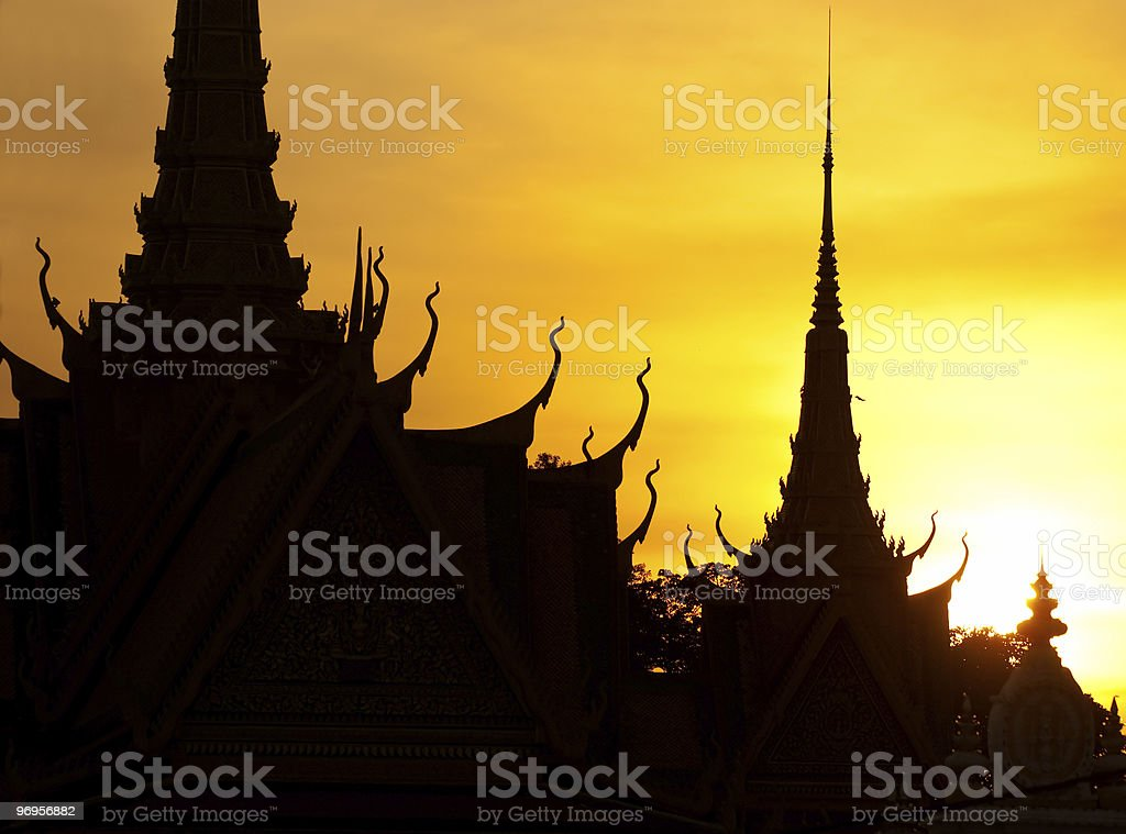 Silhouette of Royal Palace at sunset, Cambodia. stock photo