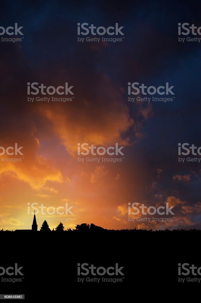 Silhouette of Rural church at sunset stock photo