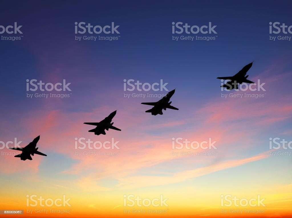 Silhouette of russian combat aircrafts with sunset sky on a background stock photo