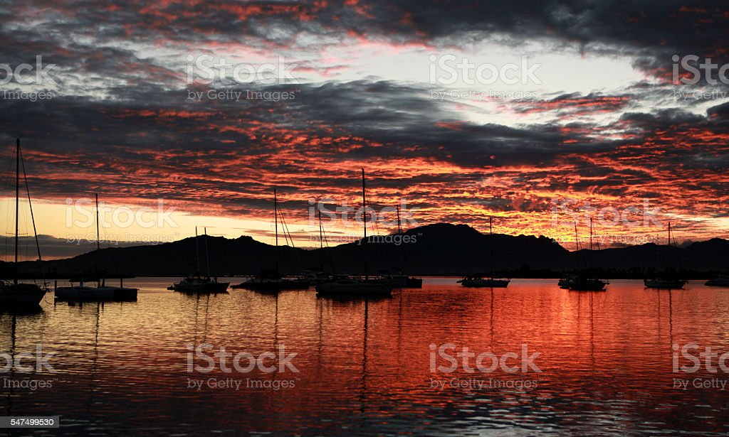 Silhouette of Sail boats at Sunrise stock photo
