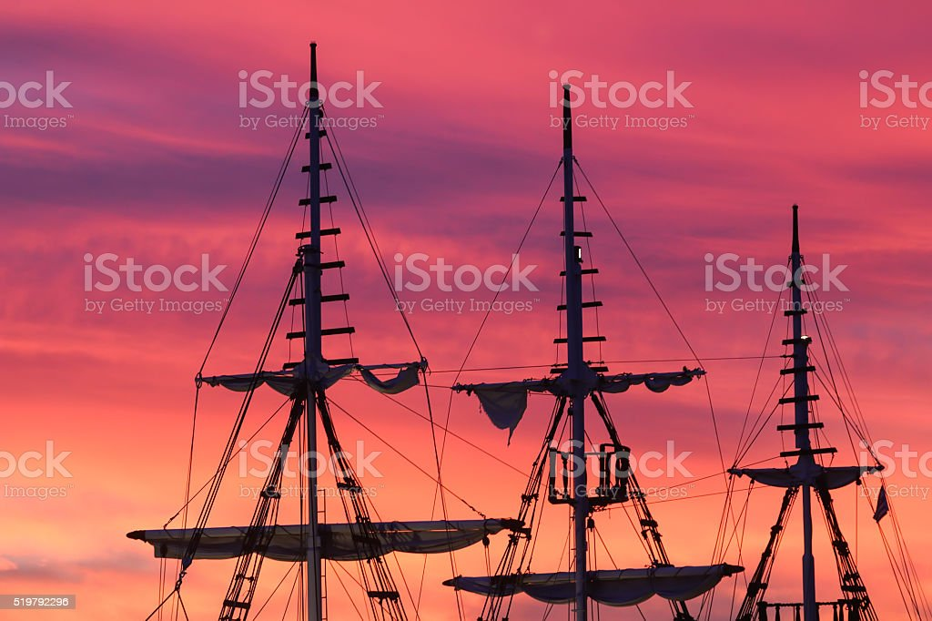 Silhouette of sails of an antique ship stock photo