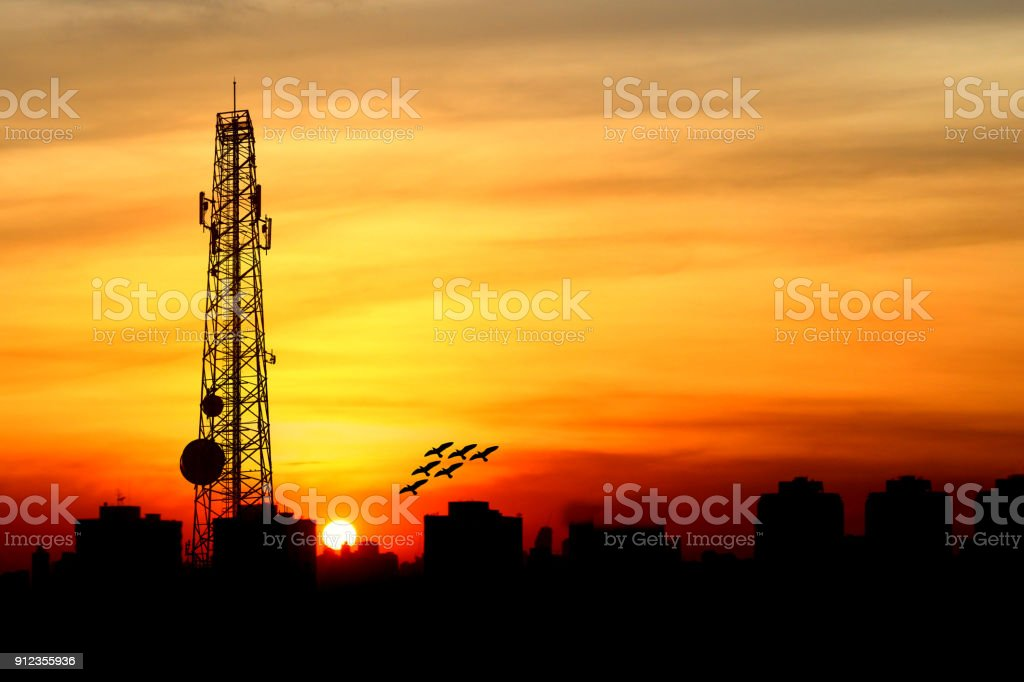 silhouette of Satellite communication antenna with the sunset stock photo