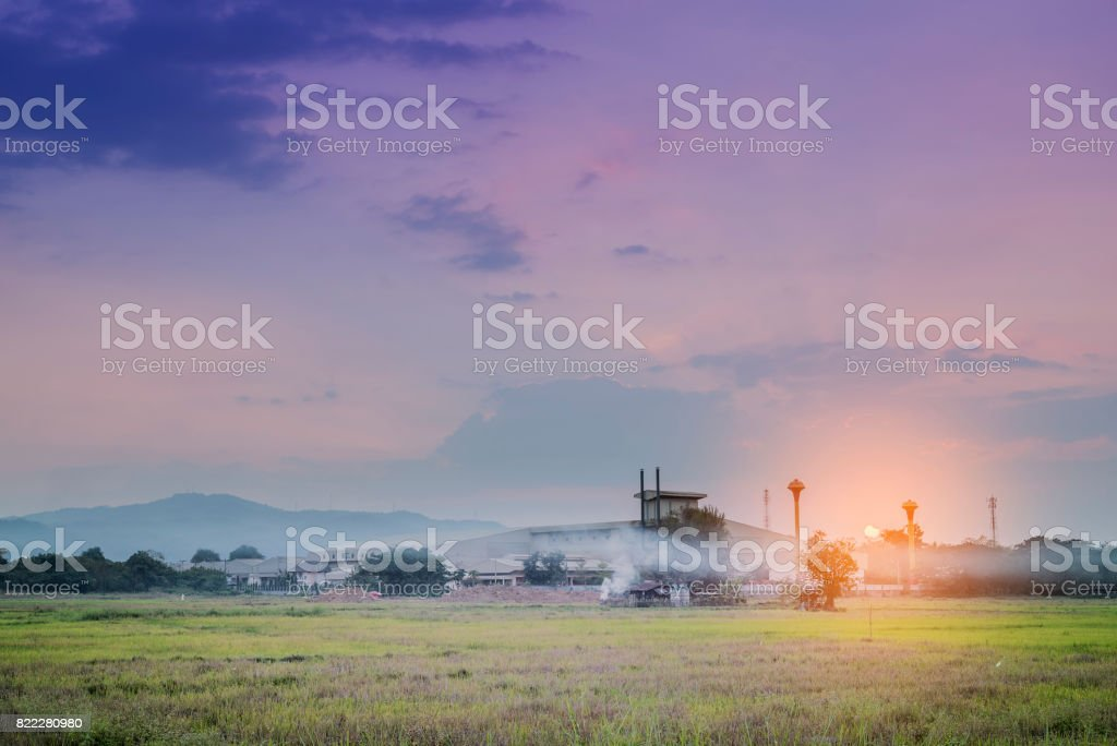 Silhouette of scaffolding in the construction site before to night time or sunset time. stock photo