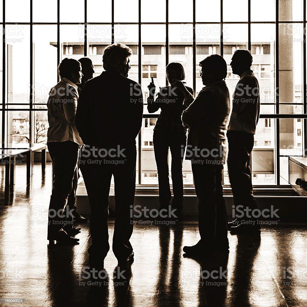 Silhouette of senior group talking royalty-free stock photo