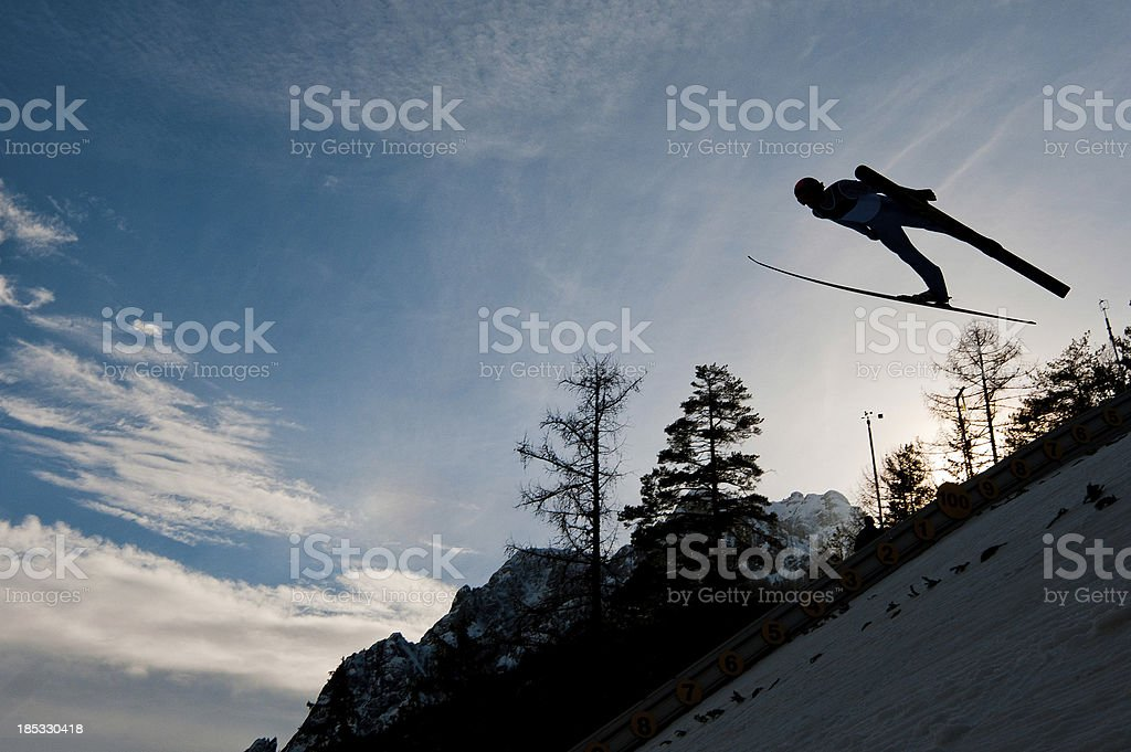 Silhouette of ski jumper flying stock photo