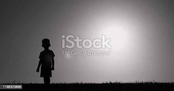 Little child walking in a field.