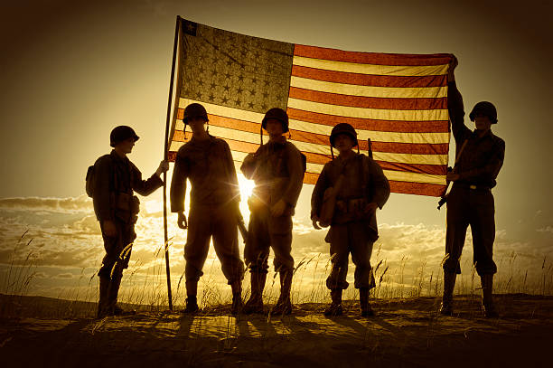 silhouette of soldiers with american flag - world war ii stock photos and pictures