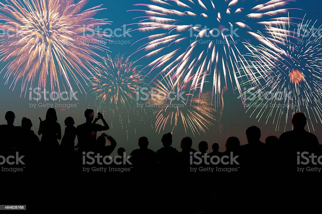 Silhouette of Spectators at Fireworks Display at Celebration stock photo