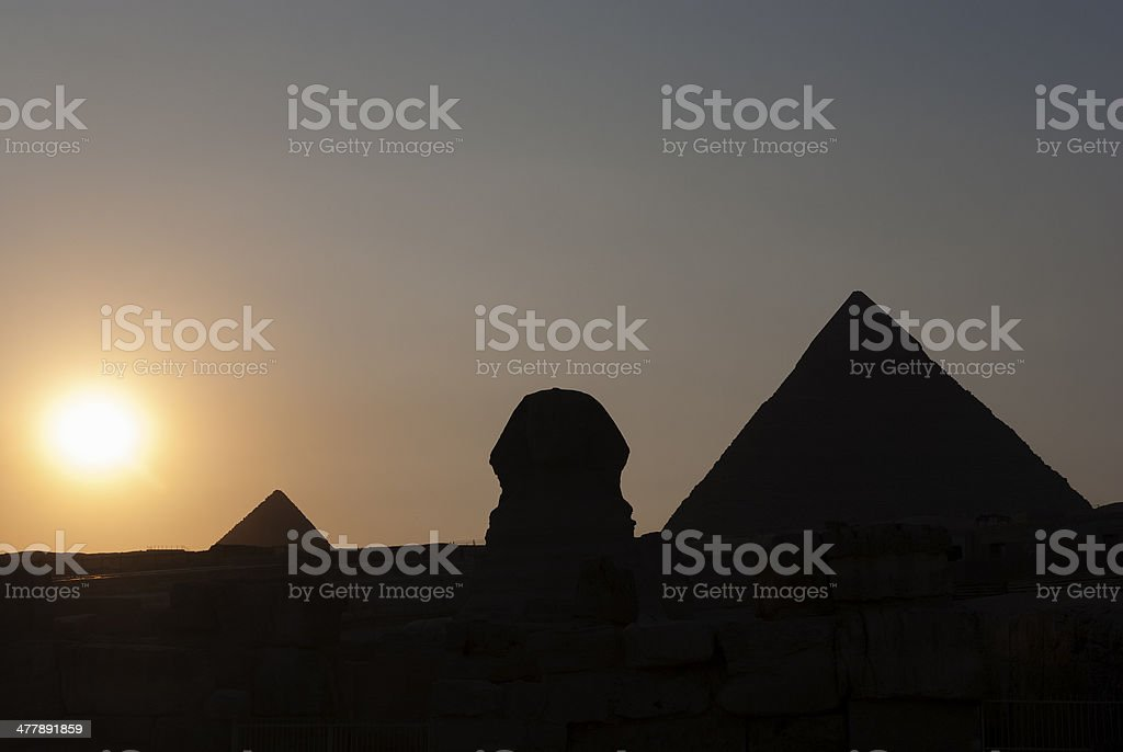 Silhouette of Sphinx and Pyramids in Giza, Cairo royalty-free stock photo