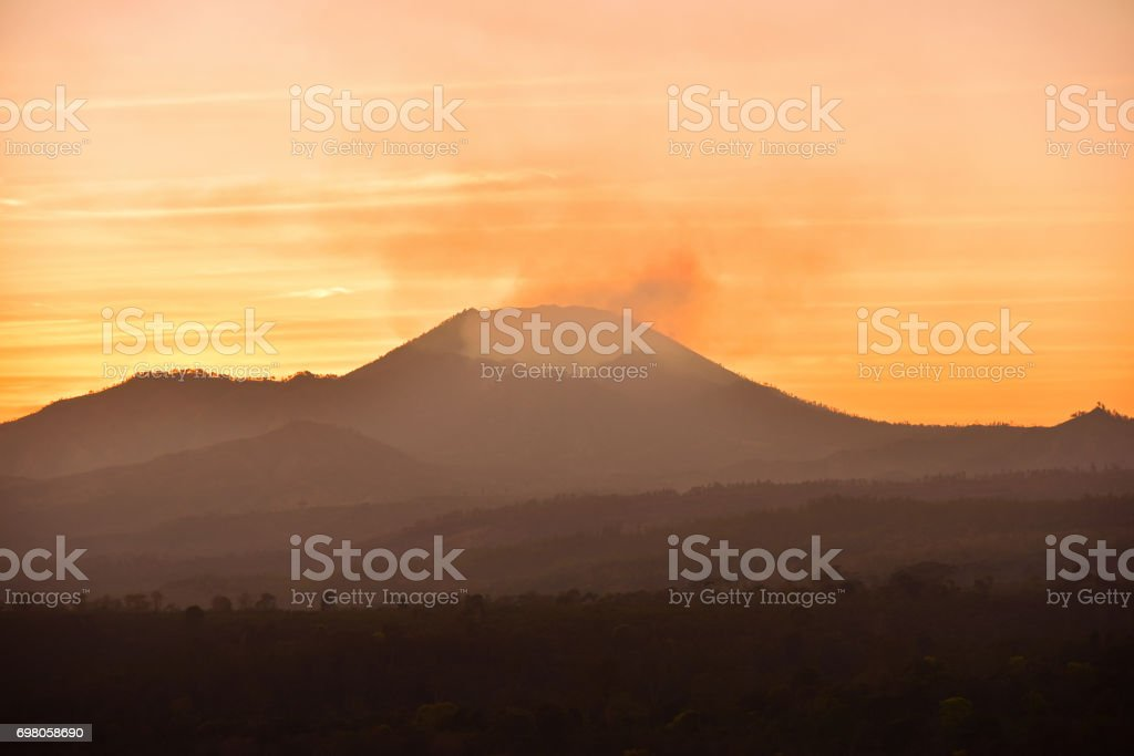 Silhouette of sunrise at Kawah Ijen crater stock photo