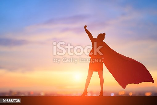 istock silhouette of super business woman 916382708