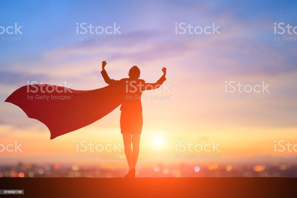silhouette of super business woman silhouette of super business woman feel strong with sunset Achievement Stock Photo