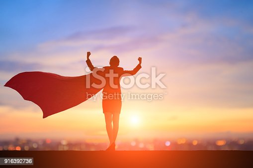 istock silhouette of super business woman 916392736