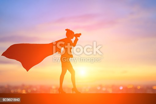 istock silhouette of super business woman 923601840
