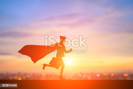 silhouette of super business woman run with sunset