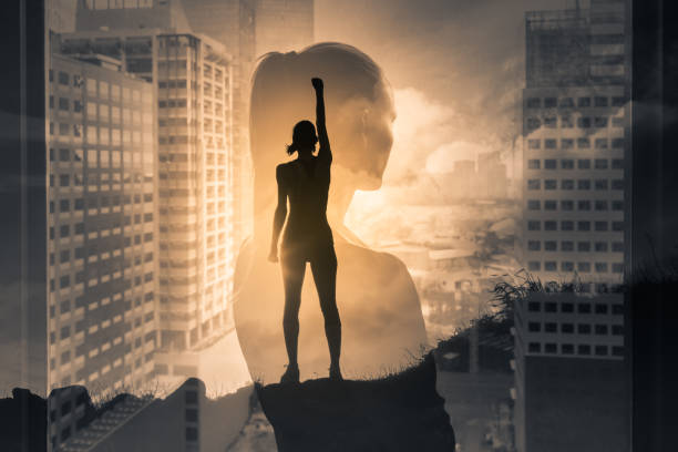 Silhouette of super strong successful businesswoman.