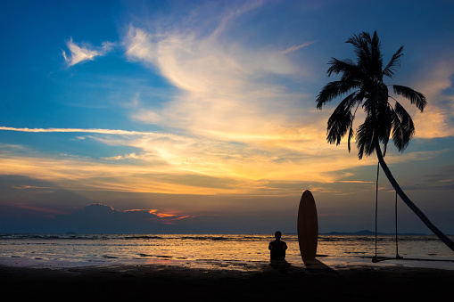 Silhouette Of Surf Man Sit With A Surfboard On The Beach Surfing Scene At Sunset Beach With Colorful Sky Outdoor Water Sport Adventure Lifestylesummer Activity Handsome Asia Male Model In His 20s Stock Photo - Download Image Now