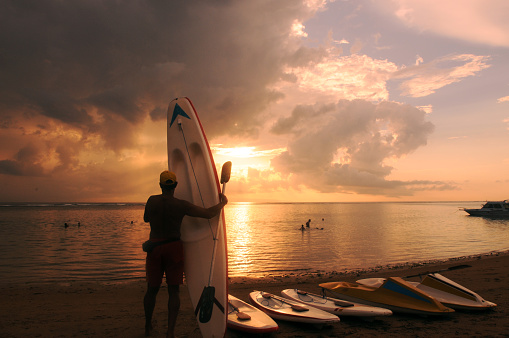 Silhouette of surfboards on Sanur beach in Denpasar, Bali, Indonesia
